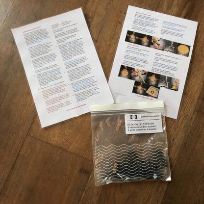 Handleiding zonnestralenspel + reserve-elastieken